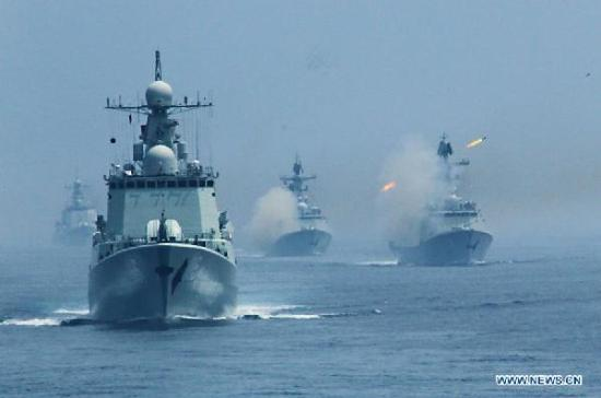 "Chinese naval vessel fire anti-submarine missile during the ""Joint Sea-2013"" drill at Peter the Great Bay in Russia, July 10, 2013."